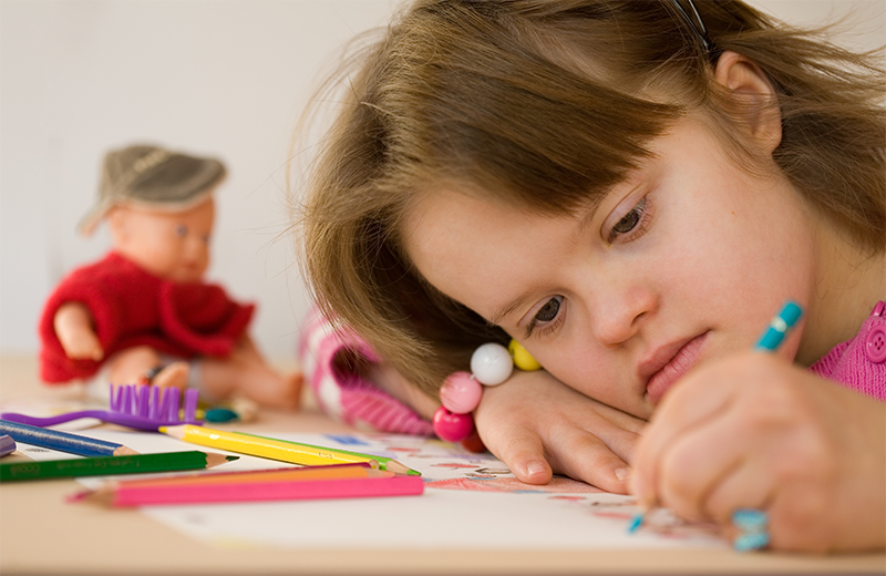 Stock image of disabled girl drawing