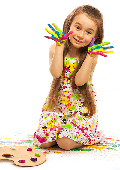 Stock image of young girl displaying paited hands